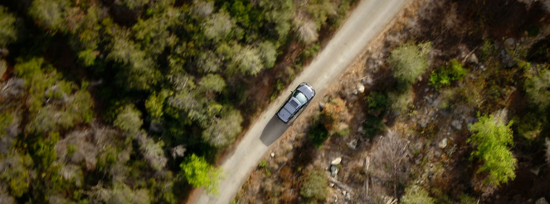 An overhead photo of the new 2019 Honda Passport driving over a dirt road.