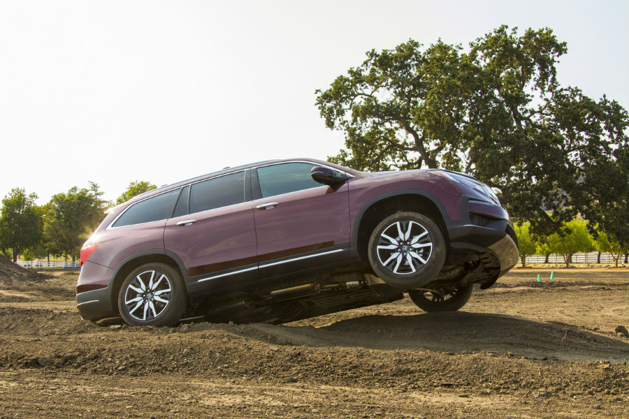 A photo of the 2020 Honda Pilot leaving the ground going over a jump.