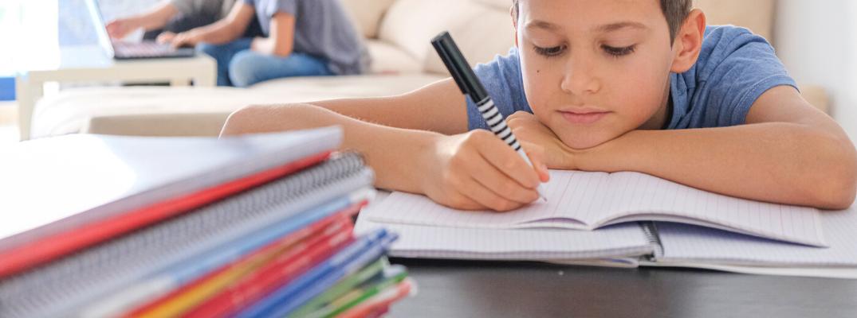 Kid coloring in coloring book