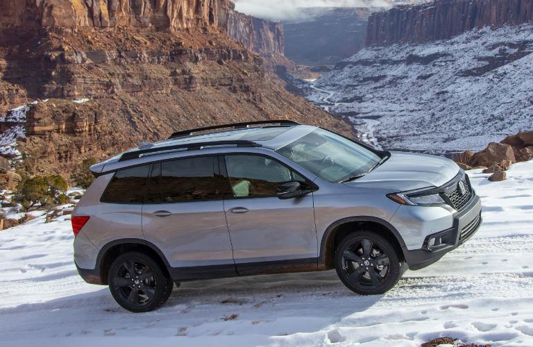 Silver 2020 Honda Passport on snowy mountain