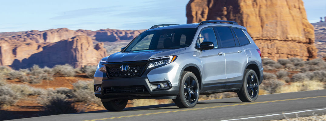 Silver 2020 Honda Passport in front of mountains