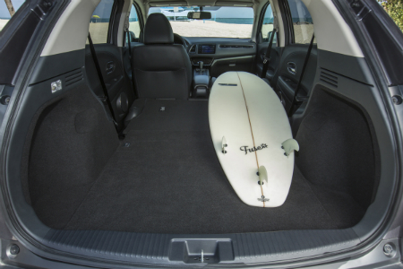 rear cargo space of 2018 honda hr-v with second-row and front passenger seats folded down with surf board fitting inside