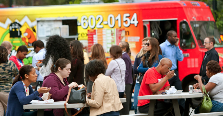people eating at food truck