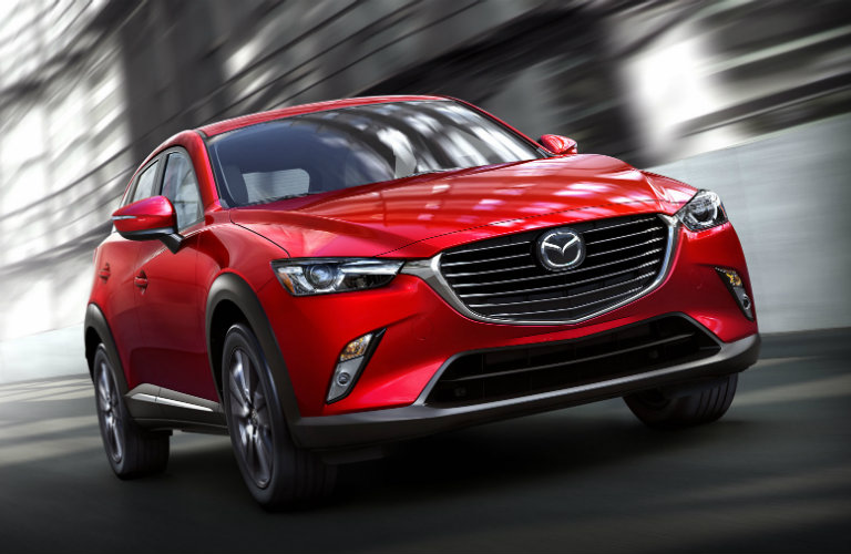 2018 Mazda CX-3 driving down road.