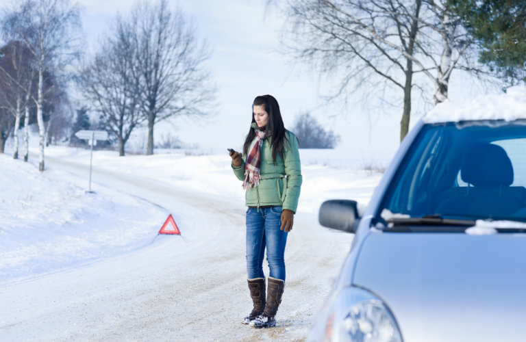 Woman-calling-for-help-after-car-break-down-in-winter