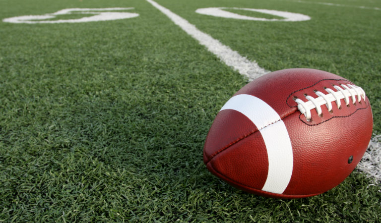 Football-laying-on-fifty-yard-line