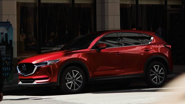 2018 Mazda CX-5 parked by a building on a street