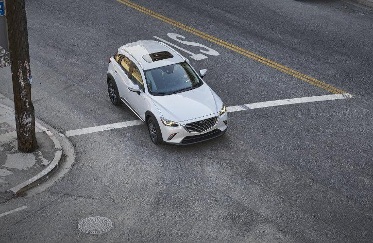 Birds-eye-view-of-2018-Mazda-CX-3-turning-corner-on-city-street