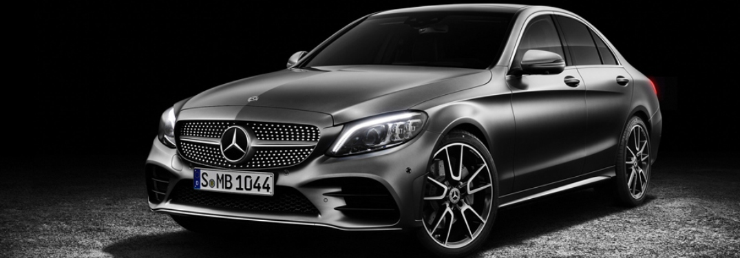 Gray 2019 Mercedes-Benz C-Class on a black background