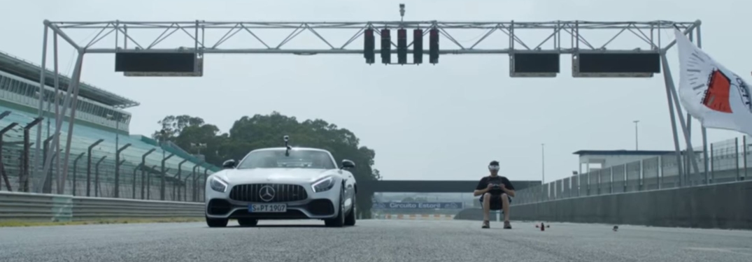 Mercedes-Benz sports car and racing drone at starting line
