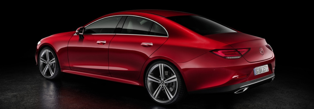 Side view of a red 2019 Mercedes-Benz CLS on black background