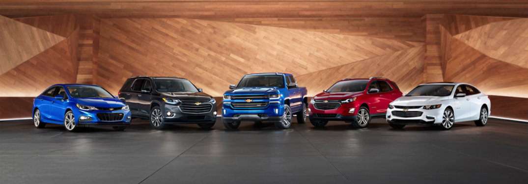 Chevy lineup with concrete floor and wood walls