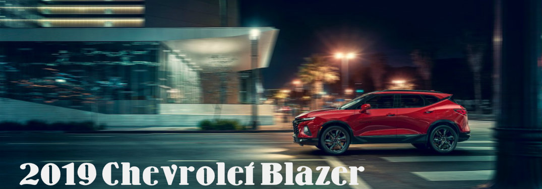 2019 Chevrolet Blazer side profile driving through city at night