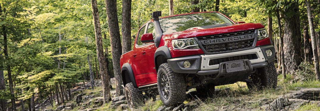 2019 Chevrolet Colorado ZR2 Bison in red color driving through forest