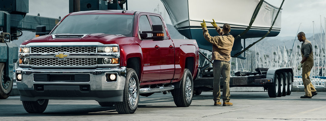 2019 Chevy Silverado pulling a trailer and a boat