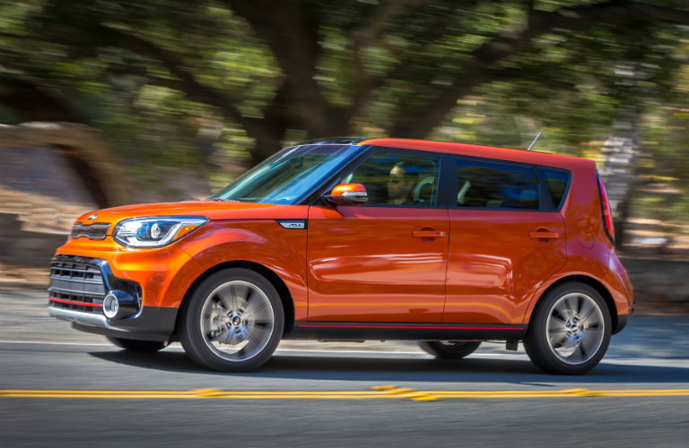 orange kia soul driving