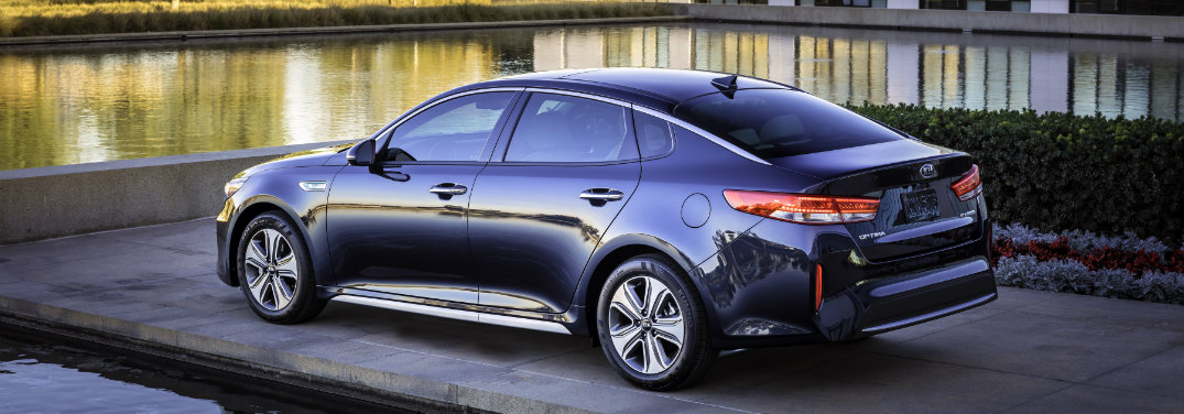 dark blue Kia Optima Hybrid by water