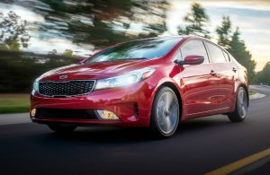 2019 Kia Forte in red driving down the road