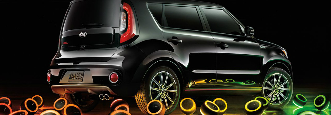 2019 Kia Soul in Shadow Black surrounded by colorful speaker lights