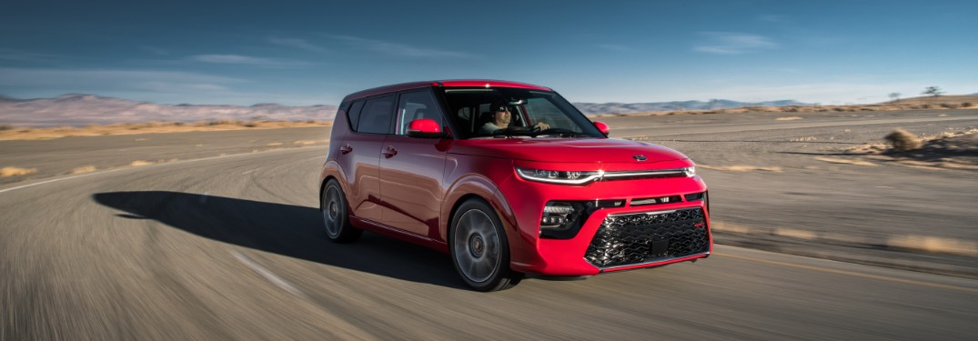 red kia soul driving