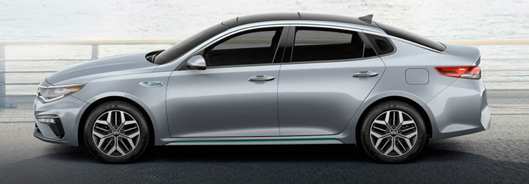 2020 Kia Optima silver exterior driver side in front of body of water