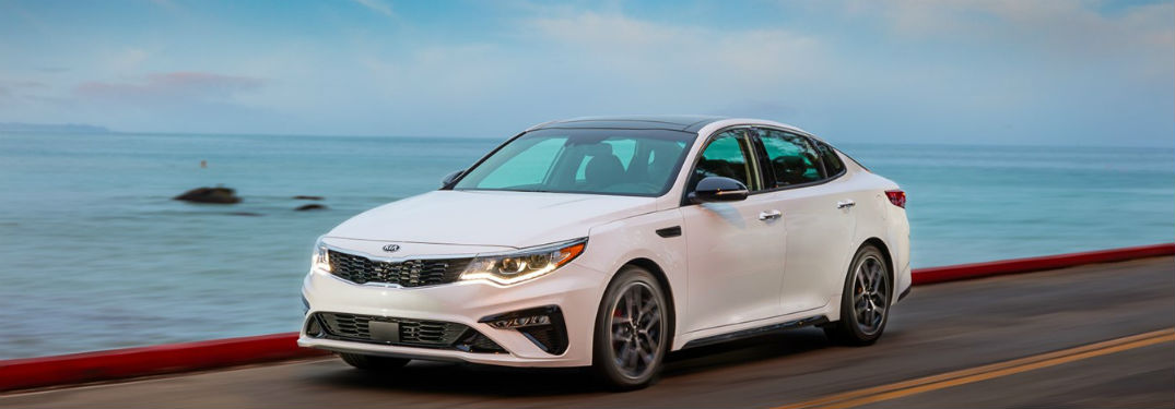 2020 Kia Optima front fascia driver side driving in front of ocean