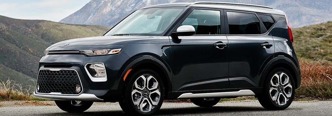 The front and side view of a black 2021 Kia Soul.