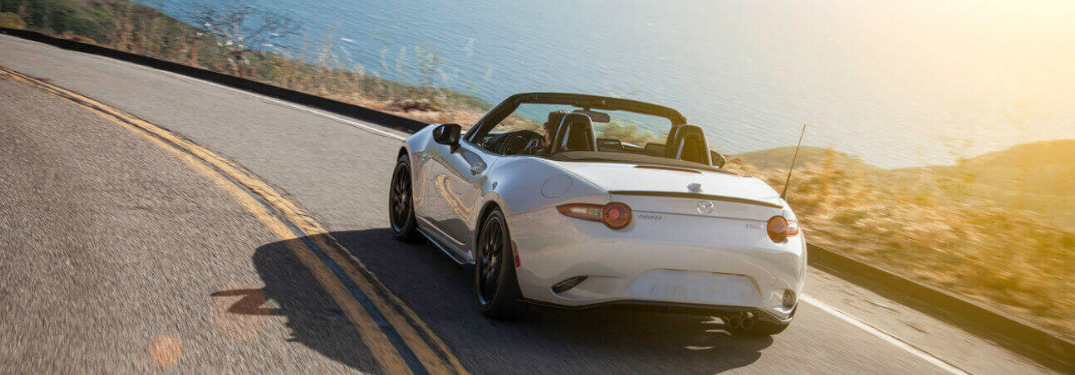 White 2018 Mazda MX-5 Miata Driving on a Coastal Road