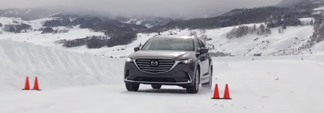 Grey Mazda CX-5 Driving on a Snowy Road