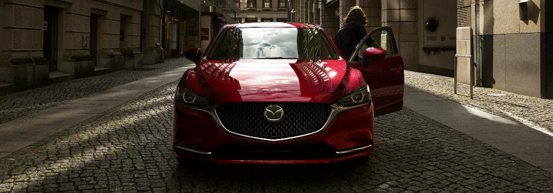 Woman Opening the Door of Red 2018 Mazda6
