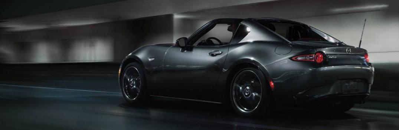 2018 Mazda MX-5 Miata black paint in tunnel with neon lights