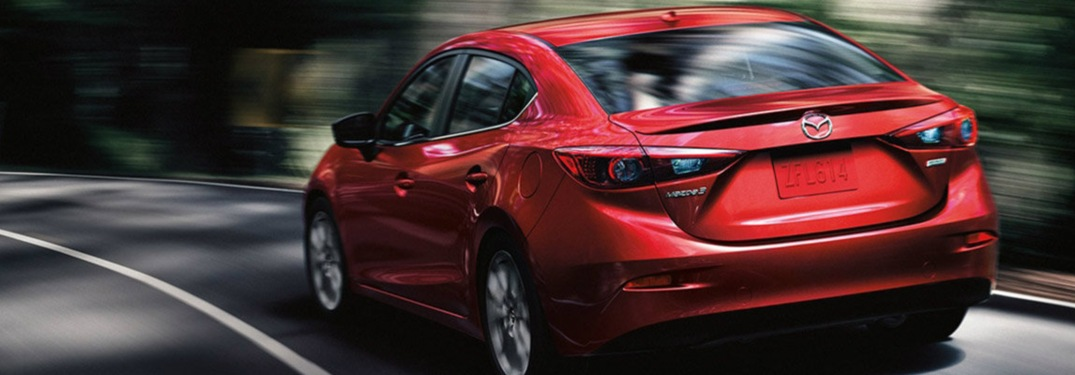 2018 Mazda3 driving down a road