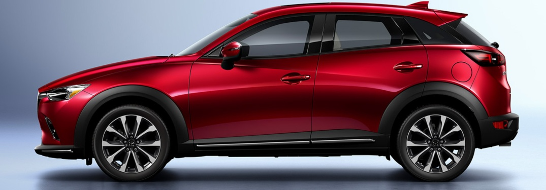 Red 2019 Mazda CX-3 over an abstract background