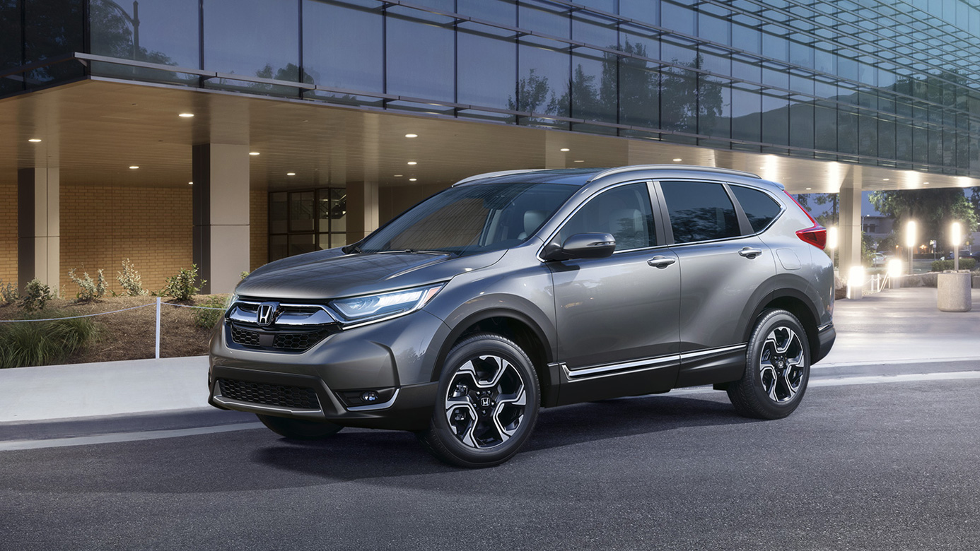 Image of a gray 2018 Honda CR-V parked in front of a glass building.