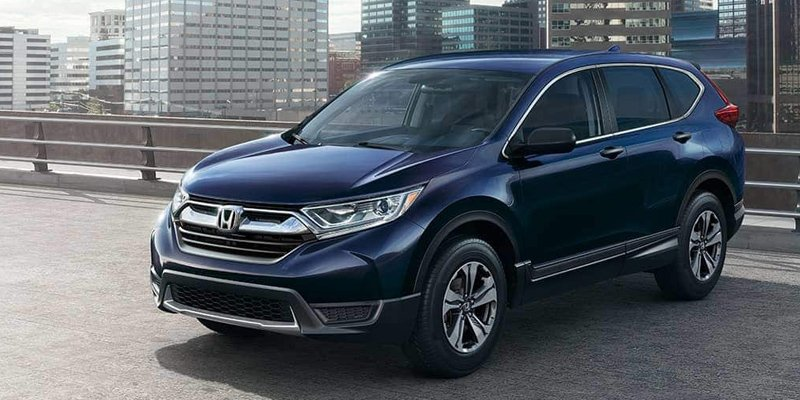 Image of a blue 2019 Honda CR-V parked in a city.