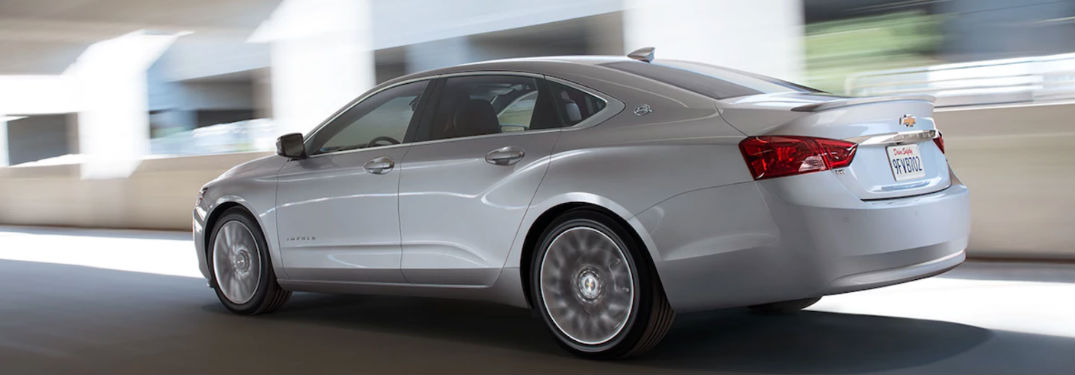 White 2018 Chevy Impala driving on road