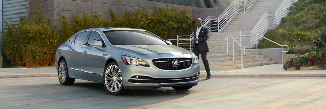 Buick LaCrosse parked with man approaching door