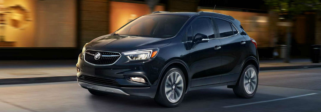 2018 Buick Encore driving on road showing side profile