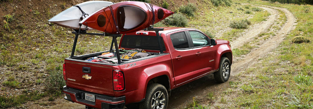 2018 Chevy Colorado driving off-road while hauling a kayak
