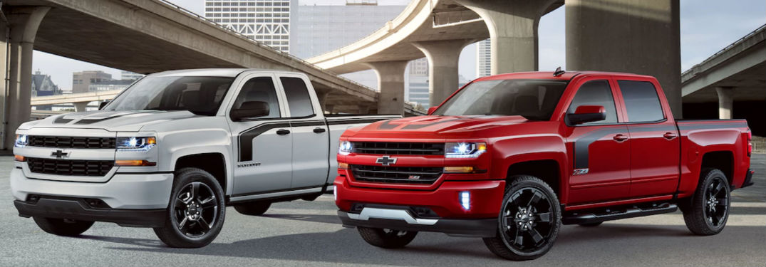 Two 2018 Chevy Silverado 1500 Rally Editions parked side-by-side