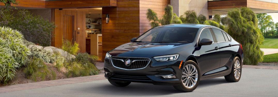 2018 Buick Regal Sportback parked in front of a house