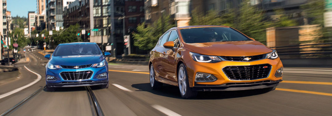 2018 Chevy Cruze sedan and hatchback driving on a road