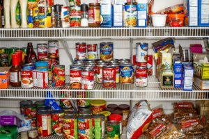 food pantry shelves stocked with various food donations