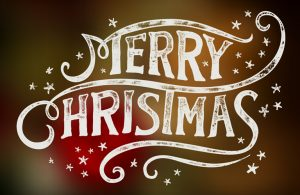Merry Christmas written in white festive lettering