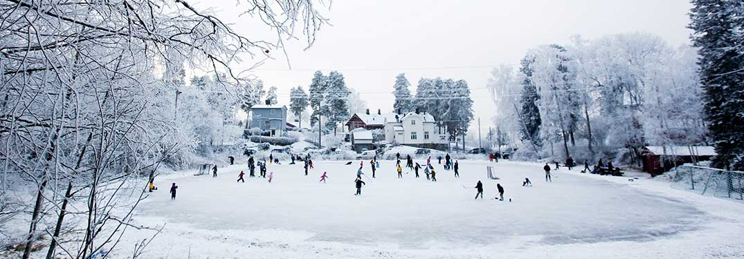 wide angle view of a people at an outdoor ice skating rink