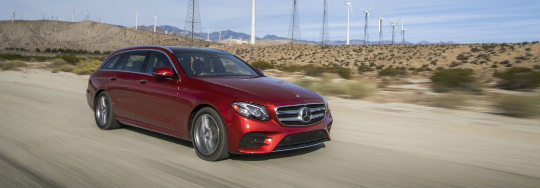 red 2018 Mercedes-Benz E-Class Wagon driving along a desert road