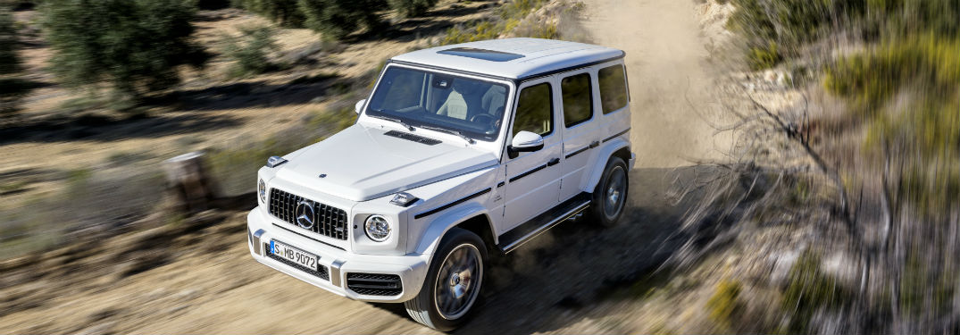 white 2019 Mercedes-AMG G 63 driving off-road