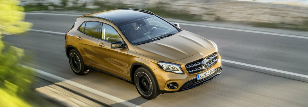gold 2018 mercedes-benz gla 250 driving along on single-lane highway