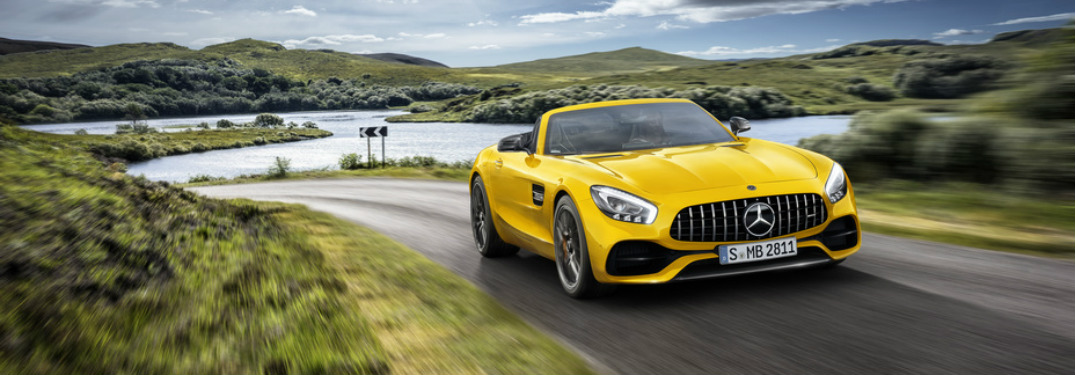 Yellow 2019 Mercedes-AMG® GT Roadster on scenic drive