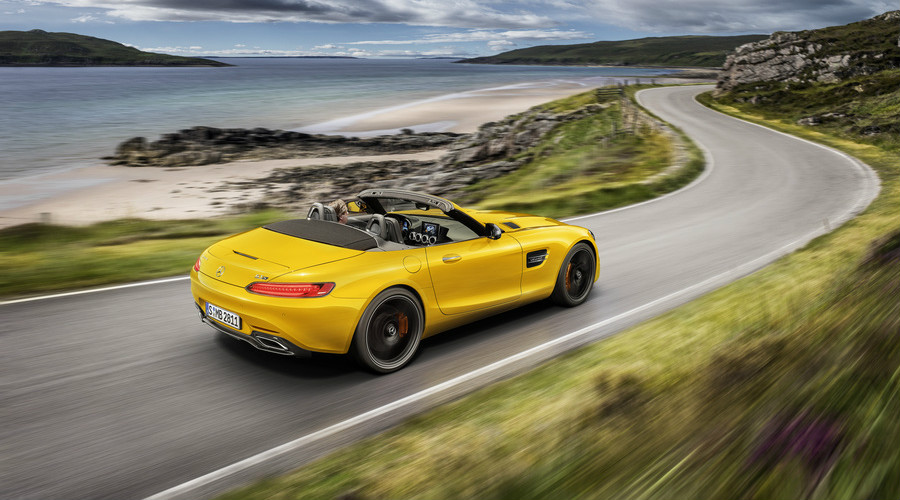 Rear overhead view of a yellow 2019 Mercedes-AMG® GT Roadster